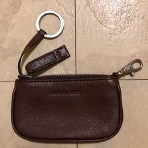 Michael Kors mini leather wallet with key chain.